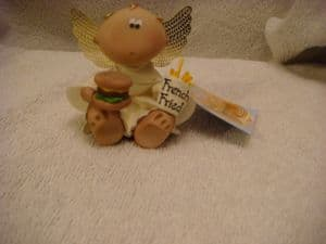 Angel Cheeks holding a burger and French fried.