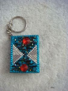 Hand finished bling keyring note pad in light blue..