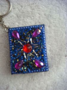 Hand finished bling keyring note pad in purple..