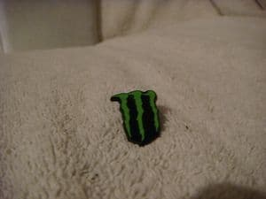 Monster soft drink logo  pin badge  in green.