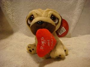 Pugsley the Pug 6inch holding a red heart with the words pugs and kisses.