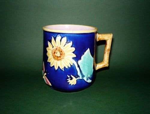 Griffen, Smith & Hill (Etruscan) Cobalt Majolica Mug with Sunflower & Butterfly c1880