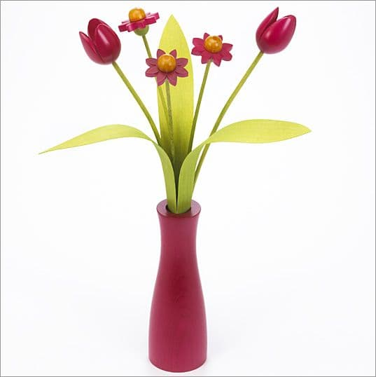 3 pink Daisies, 2 pink Tulips with 3 green leaves with pink 'cool' vase