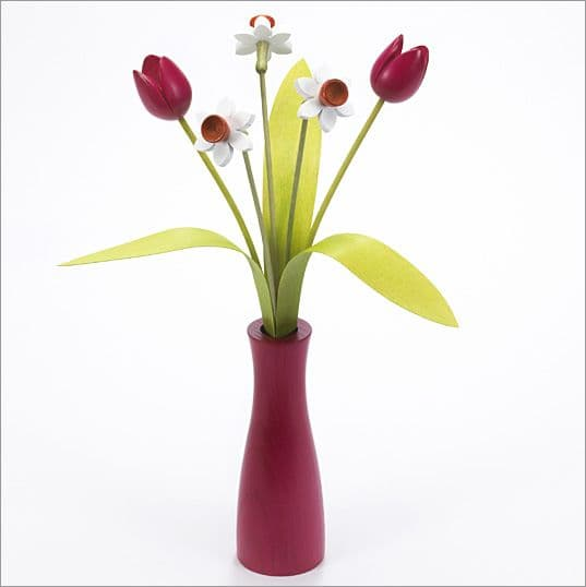 3 white Daffodils, 2 pink Tulips with 3 green leaves with pink 'cool vase