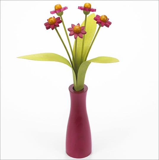 5 pink Daisies with 3 green leaves with pink 'cool' vase