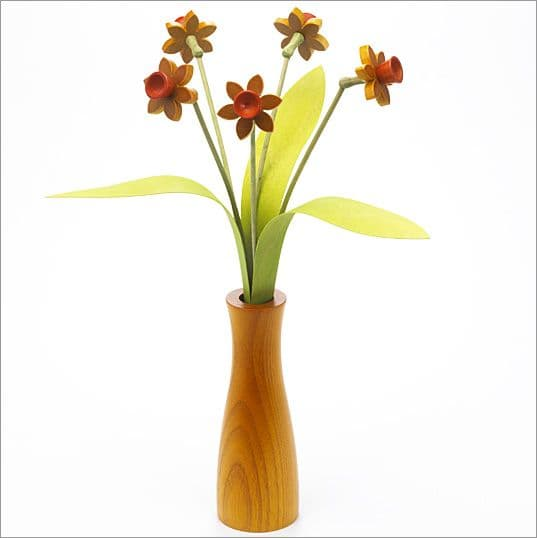 5 yellow Daffodils with 3 green leaves with yellow 'cool' vase