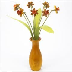 7 yellow Daffodils with 3 green leaves with yellow 'classic' vase