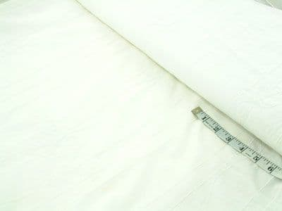 Embroidered white cotton lawn dressmaking fabric